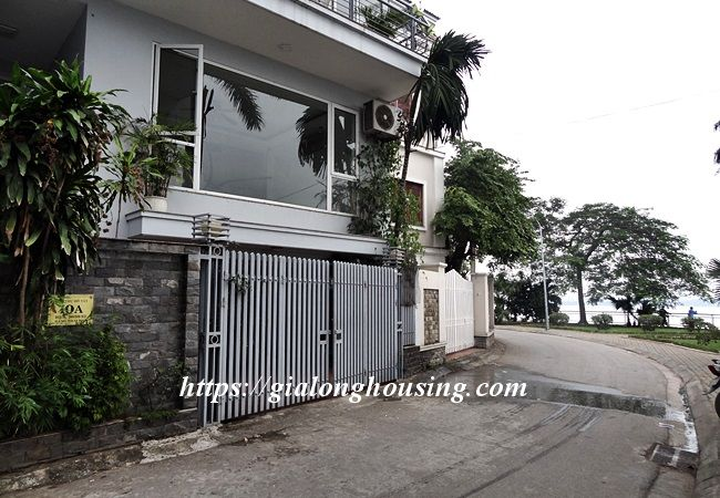 Lake front unfurnished house with car garage, Dang Thai Mai 2
