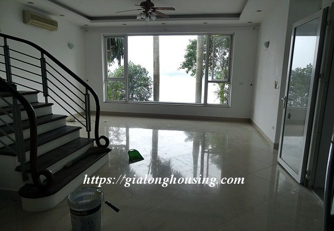 Lake front unfurnished house with car garage, Dang Thai Mai 6