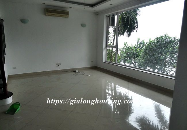 Lake front unfurnished house with car garage, Dang Thai Mai 7