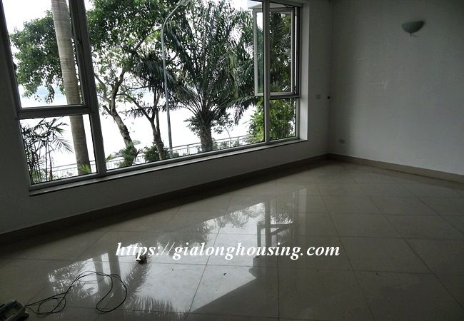 Lake front unfurnished house with car garage, Dang Thai Mai 8