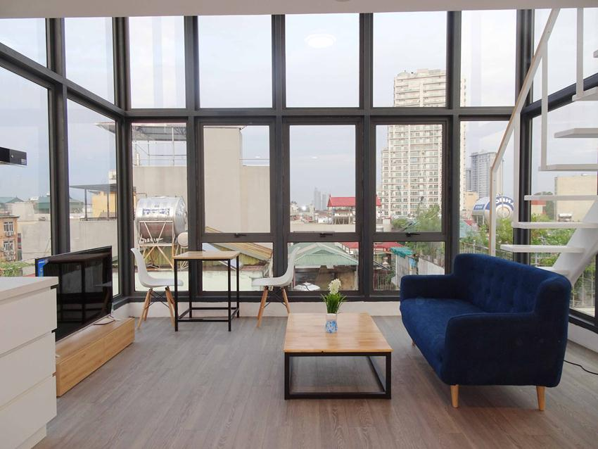 Unique rooftop duplex apartment with all glass wall